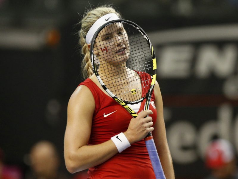 Canada's Eugenie Bouchard reacts after losing a point against Slovakia's Kristina Kucova during their Fed Cup tennis match at the PEPS stadium at Laval University in Quebec City, April 19, 2014. REUTERS/Mathieu Belanger (CANADA - Tags: SPORT TENNIS) - RTR3LXQK